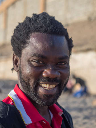 Senegal, Africa - January 24, 2019: Portrait of a happy black man from Senegal. Éditoriale