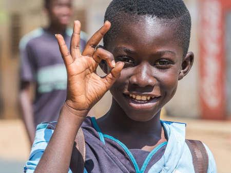 Senegal, Africa - January 24, 2019: Portrait of a black boy in blue uniform. Senegal Africa.