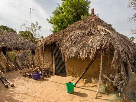 Senegal, Africa - January 2019: Traditional African small village with clay houses covered with palm leaves Stock fotó