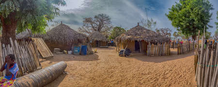 Senegal, Africa - January 2019: Traditional African small village with clay houses covered with palm leaves. Panoramic view.