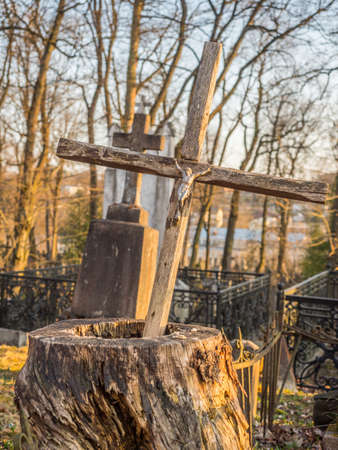 Užupis, Vilnius, Lithuania - April 08, 2018: Bronze Angels and cross on a tomb on local cemetery in Vilnius, Europe
