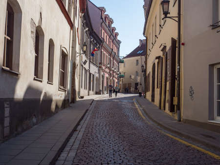 Vilnius, Lithuania - April 2018: Historic tenements along Vilnius street 免版税图像
