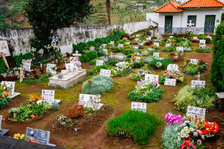 Madeira, Portugal - February 2019: Graves in a small cemetery on the island of Madeira, Portugal. Europe.