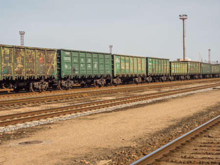 Klaipeda, Lithuania - April 07, 2018: Green wagons of a cargo train on the train station in Klaipeda 新闻类图片