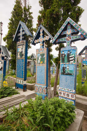 Sapanta, Romania-June 29, 2015: Colorful wooden tombstones in the cemetery