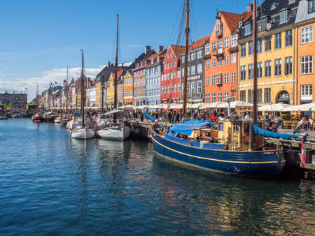 Nyhavn (New Harbor), Copenhagen, Denmark - 14 JMay 2019: Panoramic view of Nyhavn pier with color buildings, ships, yachts and other boats in the Old Town of Copenhagen, Denmark, Europe Editöryel