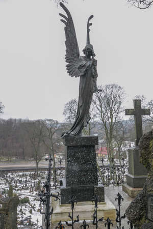 Vilnius, Lithuania - Jan 2018: Black Angel, symbol of the Vilnius cemetery on Rossa Rasos Cemetery is the oldest and most famous cemetery in the city of Vilnius.