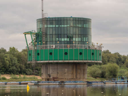 Warsaw, Poland - Aug 25 2018: Water intake in Warsaw. Fat KaÅ›ka and skinnies Wojtki, ie Warsaw Water works seen from the deck of a boat sailing on the Vistula. East Europe