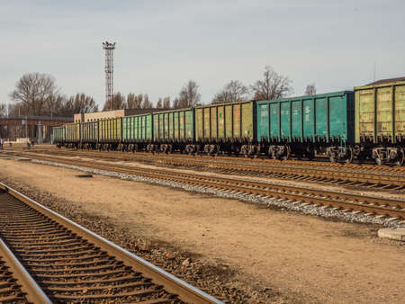 Klaipeda, Lithuania - April 07, 2018: Green wagons of a cargo train on the train station in Klaipeda Stok Fotoğraf - 161466507