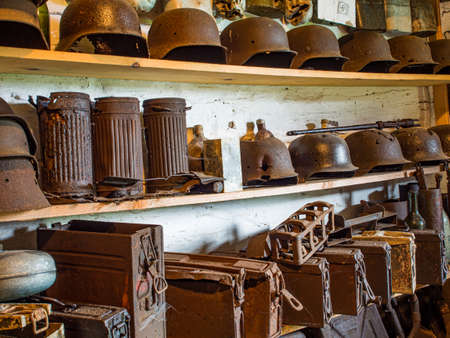 Zyndranowa, Poland - August 13, 2017: Collection of old metal helmets, vessels and other war accessories at the Lemko culture museum