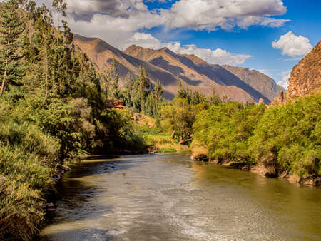 Urubamba River flowing in the Sacred Valley of Inca and view of the Andes, Peru, Cusco Province, South America.