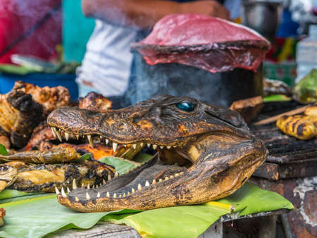 Cayman, fish and other Amazonian grilled delicacies at the Belavista bazaar in Iquitos, Peru