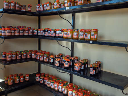 Nianing, Senegal - January, 2019: Various local fruit jams on the shelves in a small shop in a Senegalese town in West Africa 新闻类图片