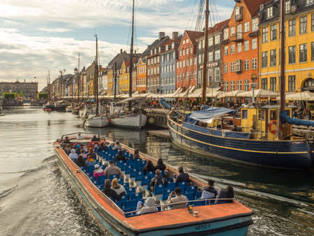 Nyhavn (New Harbor), Copenhagen, Denmark - May 2019: View of Nyhavn canal with color buildings, ships, yachts and other boats in the Old Town of Copenhagen, Denmark, Europe Stok Fotoğraf - 161762658