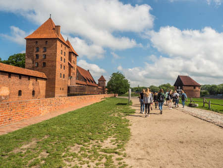 Malbork, Poland - May 22 2019: View for Teutonic Castle in Malbork (Marienburg) in Pomerania. Poland. Europe 新闻类图片