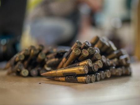 Belt with machine gun shells. Caliber Bullet Belt. Selective focus. Poland Stok Fotoğraf - 162221214