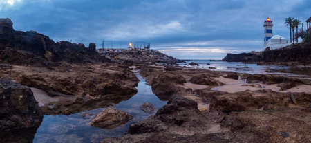 Panoramic view for Santa Marta lighthouse during ocean outflow, Sunrise at the ocean in Portugal.