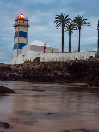 Sunrise view of Santa Marta lighthouse during ocean outflow, in Portugal.