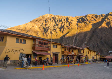 Ollantaytambo, Peru - May 20, 2016: Main square in Ollantaytambo, a town on the road to the treasures of Inca with a view for Andes mountain. Editöryel