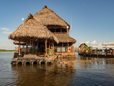 Iquitos, Peru - December 13 2017: Exclusive restaurant on the center of Amazon River. Al Frio y Al Fuego restaurant.