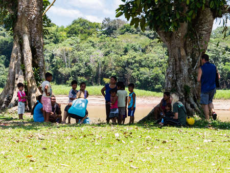 Santa Rita, Peru - Sep 19, 2018: People in a small village on the bank of the Javari rIver, tributary of Amazon River. Amazonia. South America Stok Fotoğraf - 162155996