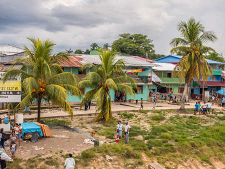 Amazon River, Peru - March 25, 2018: Small village on the bank of the Amazon River. Amazonia. South America
