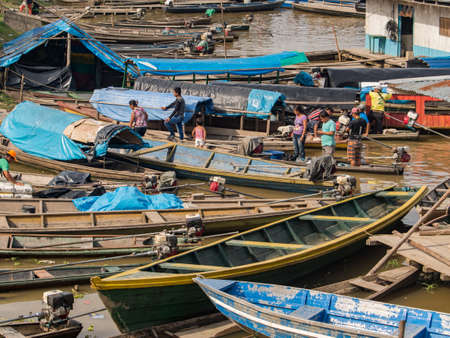 Caballococha,, Peru - Dec 11, 2017: Many traditional, indian boats on the bank of the river. Amazonia. South America.
