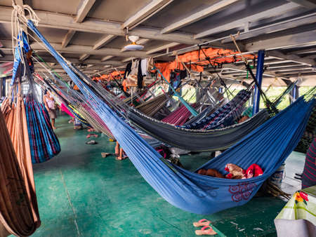 Amazon River, Peru - Sep 19, 2019: Many beautiful, colorful hammocks on the cargo boat. Amazonia, trail from Santa Rosa to Iquitos. Amazon River, Peru. South America 新闻类图片