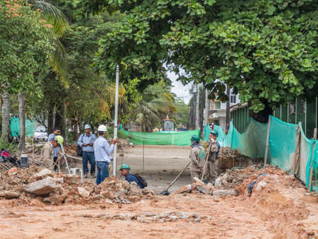 Leticia, Colombia - December 12, 2019: Construction of a new road in a small town in the Amazon on the border of three states of Colombia, Brazil and Peru. Amazonia. South America. Tres fronteras area.