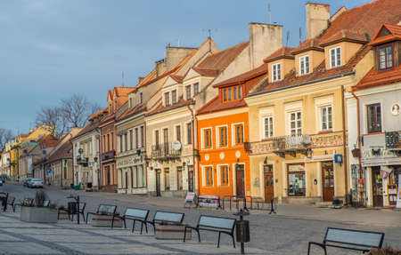 Sandomierz, Poland - February 17, 2020: Colorful tenement houses and glass benches on the market square in Sandomierz, one of the oldest and historically most important cities in Poland. Editöryel