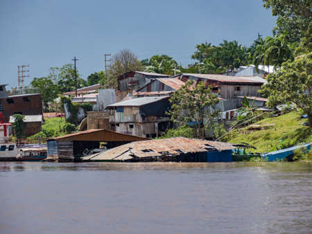 Belen, Peru- Dec 2019: Floating houses in the floodplain of the Itaya River, poorest part of Iquitos - Belén. Venice of Latin America. Iquitos, South America, Amazonia