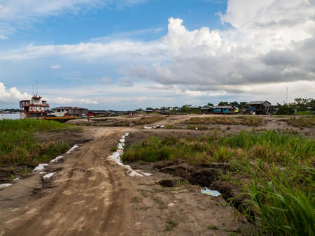 Santa Rosa, Peru - December 12, 2019: A temporary road along the Amazon River. Land flooded by water during the rainy season. Selva on the border between Colombia and Peru. Amazonia. South America. 新闻类图片