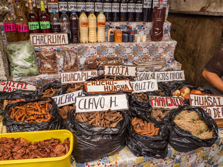 Various types of tree bark, roots and other medicinal specifics at the Belen bazaar (Belén market), Iquitos, Amazonia, Peru, South America. Original tree names on the plates 新闻类图片