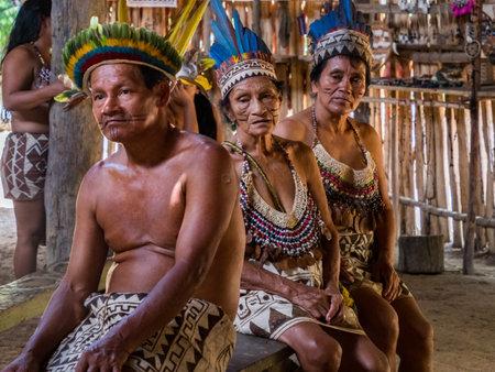 Iquitos, Peru- December 11 2019: Indian from Bora tribe in his local costume. Amazonia. Latin America. Amazon River Basin.