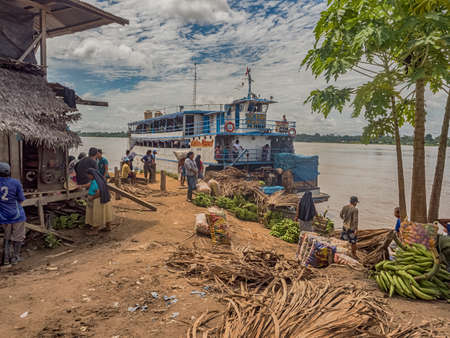 Amazon River, Peru - December 04, 2018: Slow boat in the port in a small village on the bank of the Amazon River, Amazonia, South America.
