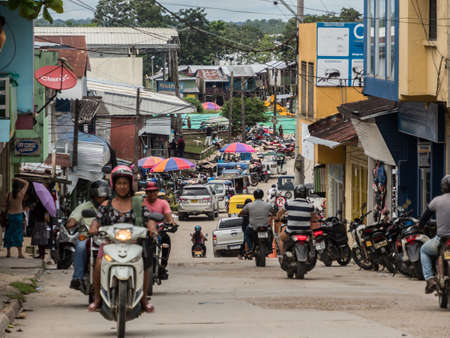 Leticia, Amazonas, Colombia, Dec 07,, 2019: Various rickshaws, motors and cars on a street of a small town. Amazonia. Latin America. Colombia