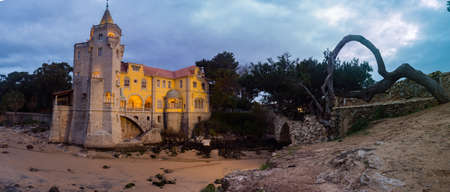 Beautiful museum building - Condes de Castro Guimarães - during sunrise with night lighting, Panoramic view. Cascais, Portugal