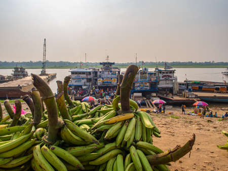 Iquitos, Peru - May 13, 2016: A lot of bananas in a port of Iquitos on Amazon River. Amazonia Latin America.