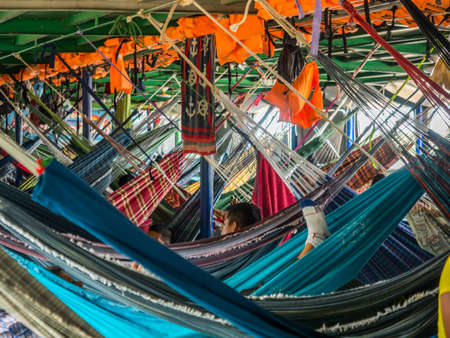 Amazon River, Peru - Sep 19, 2019: Portrait of a small girl on the hammock - an inhabitant of the Peru. Amazonia. South America