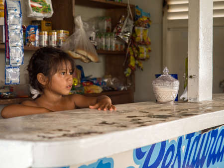 Amazon River, Peru - Sep 20, 2017: Portrait of a small girl - an inhabitant of the Peru. Amazonia, South America. 新闻类图片