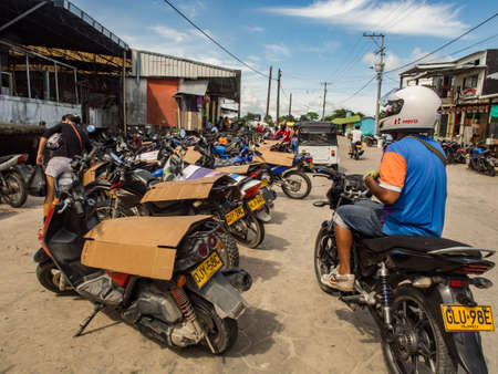 Leticia, Amazonas, Colombia, Dec 07,, 2019: Many motors on a street of a small town. Amazonia. Latin America. Colombia