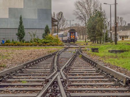 Warsaw, Poland - October 20, 2017: Crossing of railroad tracks for passenger trains at the railway depot in Olszynka Grochowska 新闻类图片
