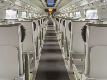 Warsaw, Poland - October 20, 2017: Interior of empty railway carriage. Modern polish economy class fast train interior. No people inside of high speed train compartment. Eastern Europe