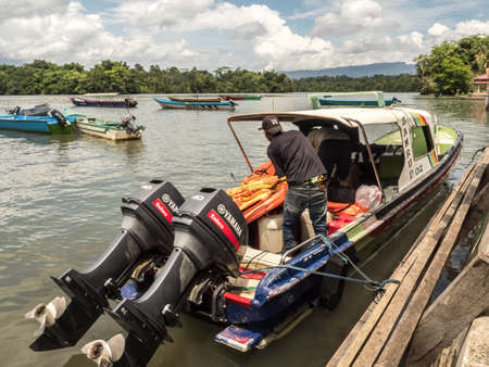 Namsan Indonesia, January 31, 2018: A boat with two engines is waiting for tourists in the small village of Namasan in West Papua, Arguni Bay, bird's head peninsula, Indonesia, Asia. Editöryel