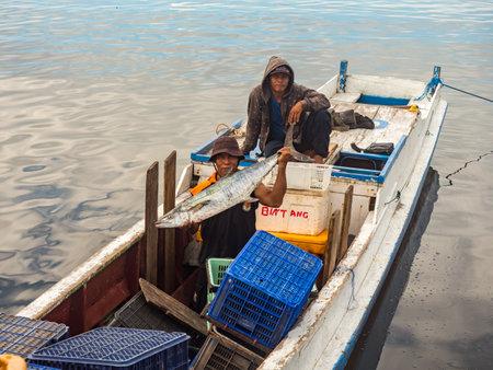 Kaimana, West Papua, Bird's Head Peninsula, Indonesia - February, 2018: Fishermen brought a huge fish to the fish market. Editöryel