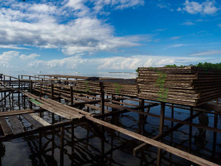 Special structures and nets prepared for drying fish in Kaimana in the Seram Sea. Bird's Head Peninsula, West Papua, Indonesia, Asia.