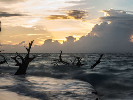 Sun set on the beautiful tropical beach on the small island, Venu Island, Pulau Venu, near Kaimana, West Papua, Indonesia, Asia