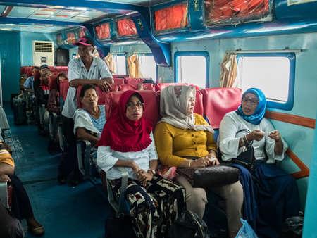 Seram Island, Indonesia - February 2018: Passengers inside a boat floating between the islands on the Maluki archipelago. Second class. Island of Seram, Maluku, Indonesia, Asia