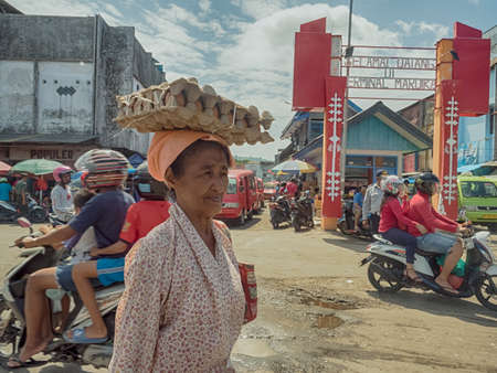 Ambon., Indonesia - Feb, 2018: Crowd of the local people selling and buying different goods on the market, Island of Ambon, Maluku, Indonesia. Asia Editöryel
