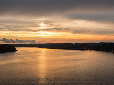 A view at the sunset above the Goluń lake from the observation tower in Wdzydze Kiszewskie. Bory Tucholskie. Wda River. Poland. Eastern Europe